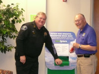 Officer and Man in front of Prescription Collection Unit
